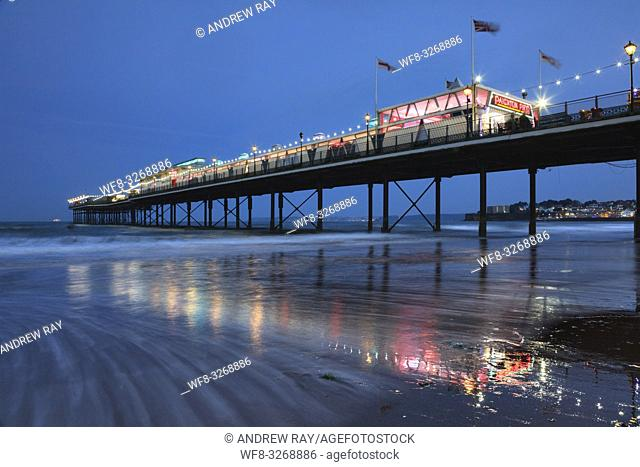 The pier at Paignton on the South Coast of Devon captured about 30 minutes after sunset using a two seconds shutter speed to blur the movements in a receding...