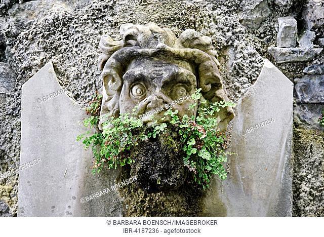 Fountain fugire, demon, grimace, in the garden of the Villa Monastero, museum, Varenna, Lake Como, Lago di Como, Lecco Province, Lombardy, Italy