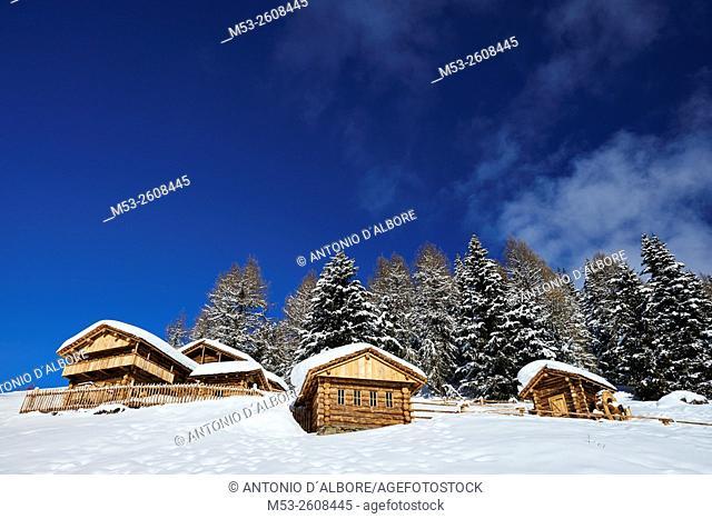 Wooden mountain chalets on Mount Elmo. sesto Municipality. Bolzano Province. Trentino-Alto Adige. Italy
