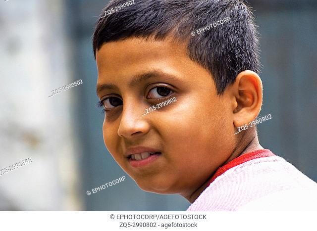 Young boy looking at camera. Pune, Maharashtra, India