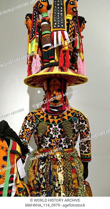 Masquerade headdress and costume (odogu) by Lawrence Ajanaku, born circa 1933, Nigeria. Medium: Cotton, cane; hessian and fabric 2013-2014