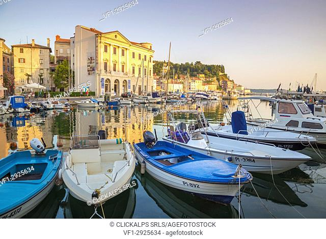 Piran, Slovenian Istria, Slovenia. The harbour at sunset with some colorful fishermen boats