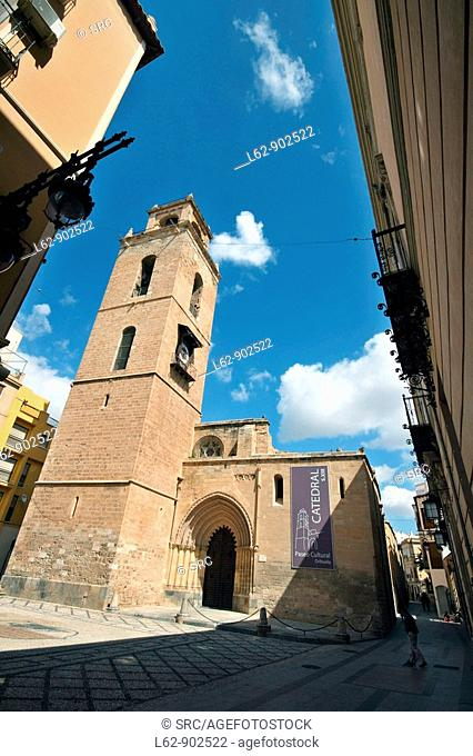 Tower and Puerta de las Cadenas Gothic front of cathedral, Orihuela. Alicante province, Comunidad Valenciana, Spain