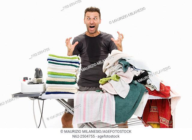 Very sweaty man, Goes berserk behind an ironing board full of clothing