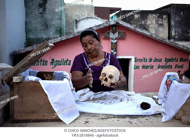 A woman cleans the bones of a deceased family member in the Mayan village of Pomuch, Hecelchakan, Campeche, Yucatán península, October 30, 2016