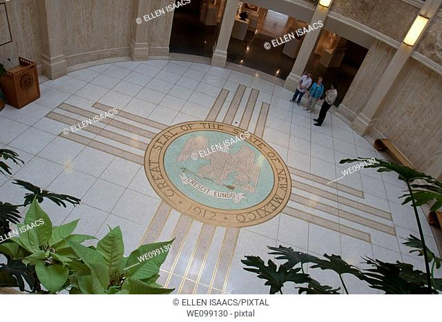 Zia sun symbol on the rotunda floor of the New Mexico state capitol building in Santa Fe