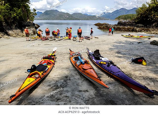 A guided kayak group prepare to depart from Rosa Island in Nuchatlitz Provincial Park on British Columbia's west coast, Canada. No Model Release