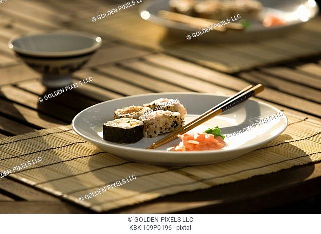 Sushi served with chopsticks on dining table