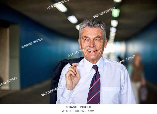 Portrait of confident senior businessman in tunnel