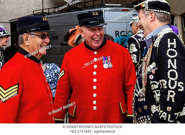Two Chelsea Pensioners Talking To A Pearly King At The Pearly Kings and Queens' Harvest Festival, Held Annually At The Guildhall Yard, London, England