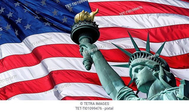 USA, New York State, New York City, Part of Statue of Liberty against american flag