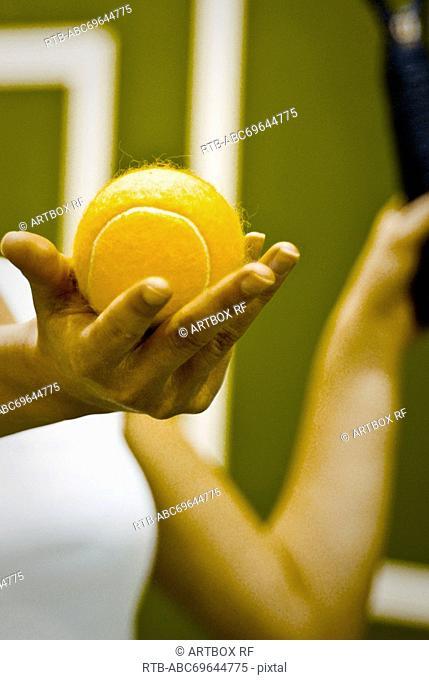 Tennis player preparing to serve the ball