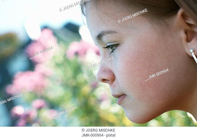 Portrait of a little girl in the garden