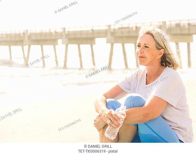 Senior woman sitting on beach