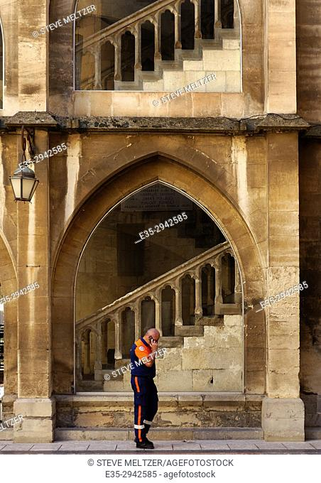 A security guard talks on the phone in the courtyard of the Archbishop's Palace in Narbonne, France