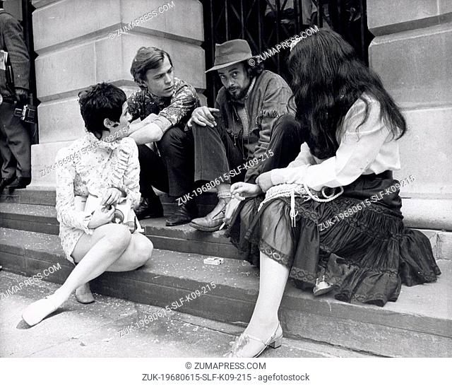 Jun 15, 1968 - London, England, United Kingdom - JOHN HOPKINS is consoled by some of his guests as he sits on the steps of St