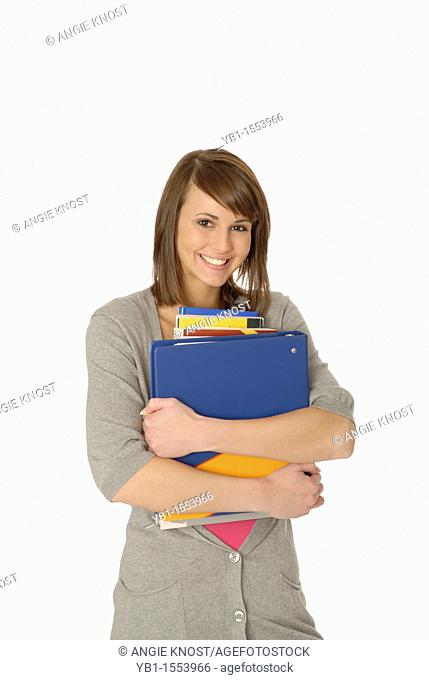 Attractive Teenage Girl Holding Books and Smiling