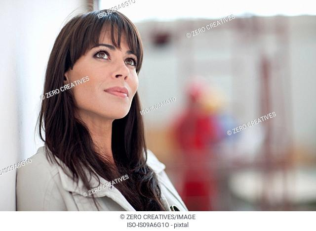 Portrait of a woman looking away in a work environment