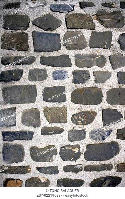 Antique grunge old gray stone wall masonry
