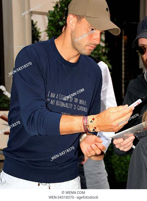 Grigor Dimitrov signs autographs while leaving his hotel during Roland Garros Tennis Tournament Featuring: Grigor Dimitrov Where: Paris