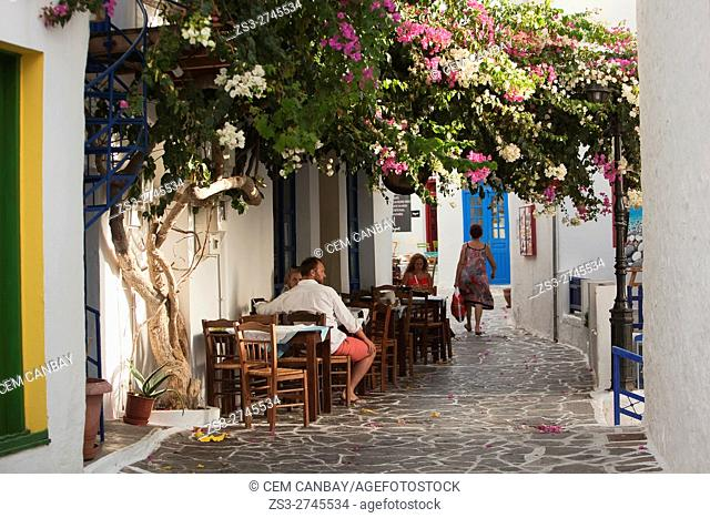 People sitting in a traditional restaurant-taverna in the old town Plaka, Milos, Cyclades Islands, Greek Islands, Greece, Europe