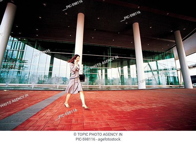 Woman Using Cellular Phone,Korean