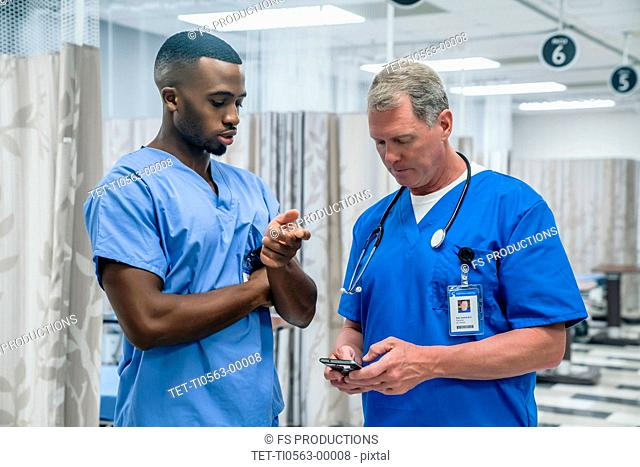 Doctor and nurse using smart phone in hospital