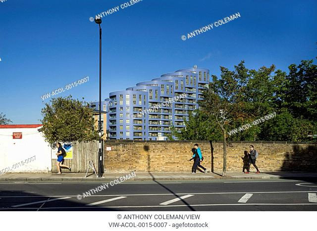 Morning street scene with view towards housing scheme. Queensland Road, London, United Kingdom. Architect: CZWG Architects LLP, 2015