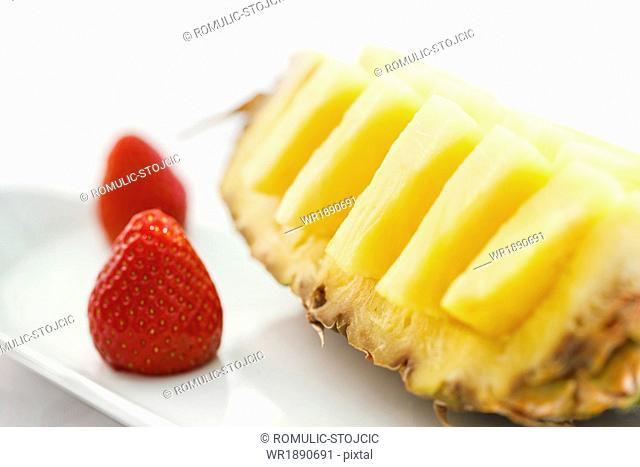 Fresh Pineapple with Strawberries on Plate