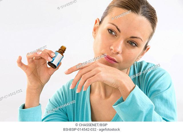 Woman smelling an essential oil