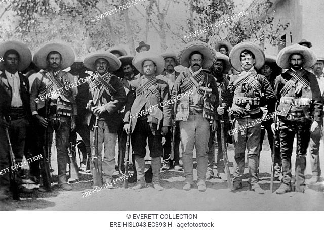 Francisco Pancho Villa and his officers after placing his soldiers under Maderos command. Villa is third from right at Maderos family estate, Hacienda Bustillos