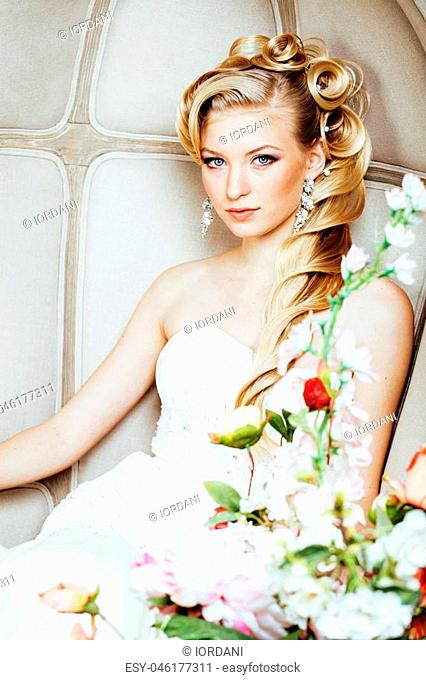 beauty young woman bride alone in luxury vintage interior with a lot of flowers close up