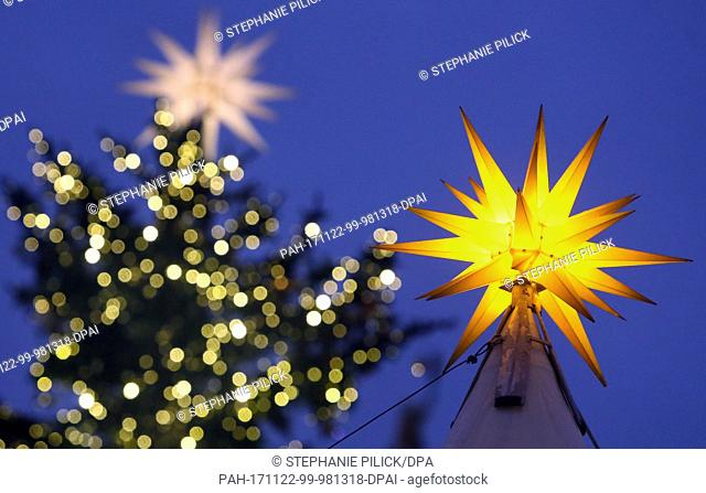 Picture of the Christmas market at Gendarmenmarkt square adorned with shining stars in Berlin, Germany, 22 November 2017