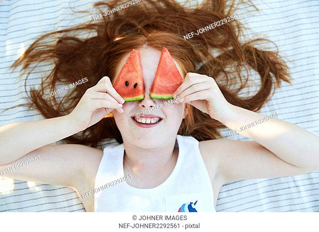 Girl and slices of water melon