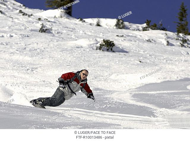 Snowboarder in red and grey clothes