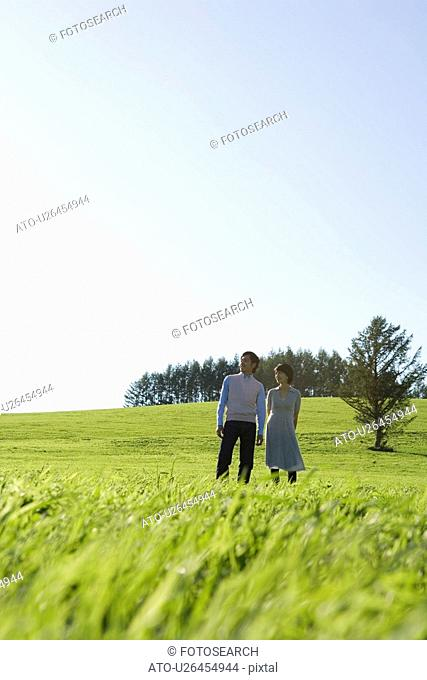Adult Couple Standing on Filed