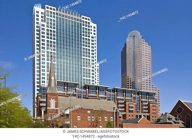 St Peters Church with modern skyscapers in downtown Charlotte North Carolina