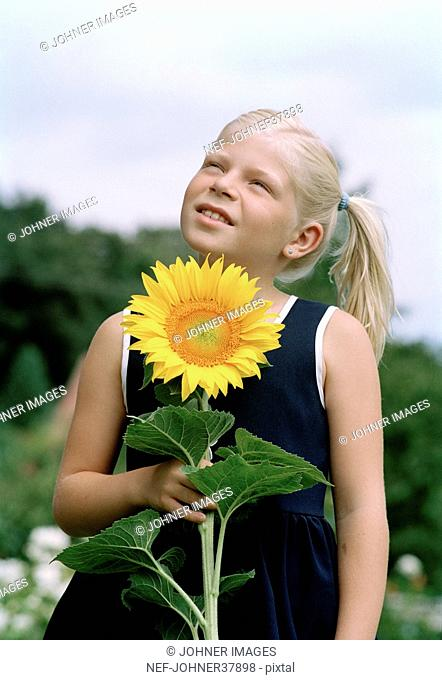 Blond girl with sunflower