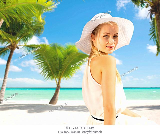 summer, vacation and lifestyle concept - beautiful woman in hat enjoying summer outdoors