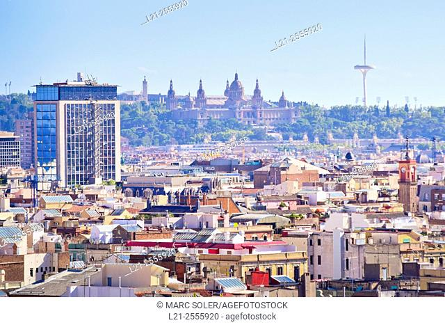 Barcelona urban landscape. From left to right Deutsche Bank building, Montjuic mountain, National Art Museum of Catalonia, and Calatrava Tower