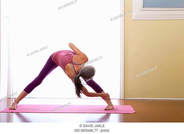 Woman bending forwards and stretching legs