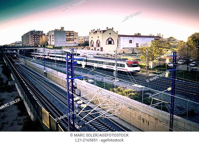 Train moving and train station at dusk. Vilafranca del Penedès, Barcelona Province, Catalonia, Spain
