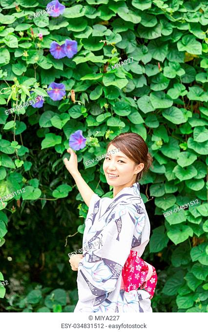 "attractive asian woman wearing traditional Japanese casual summer kimono called """"Yukata"""""
