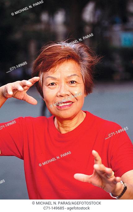 Senior woman doing Tai-Chi