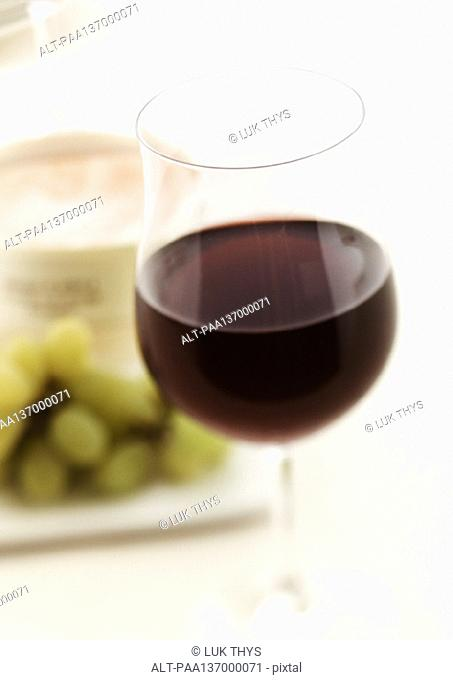 Glass of red wine, blurred