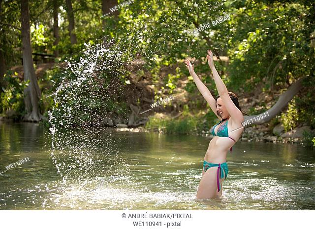 Bikini girl posing at a river