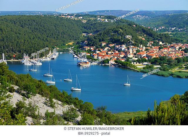 Townscape with sailing ships in the foreground, River Krka, Skradin, Dalmatia, Croatia