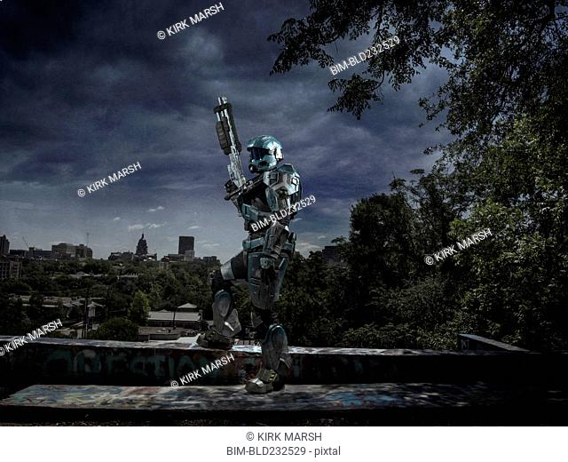 Robot patrolling city holding rifle