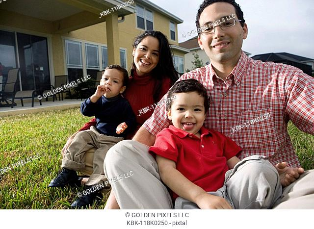Portrait of a family sitting on lawn