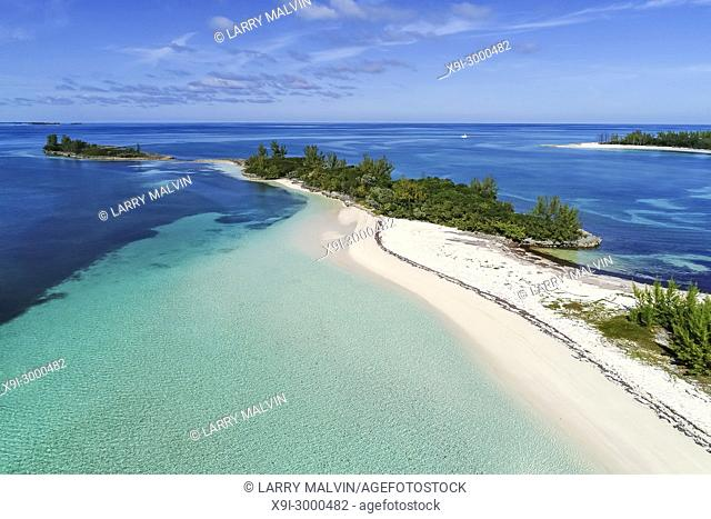 Aerial view of Munjack Cay with bay and beach in Abaco, Bahamas. Green turtles and stingrays inhabit the area